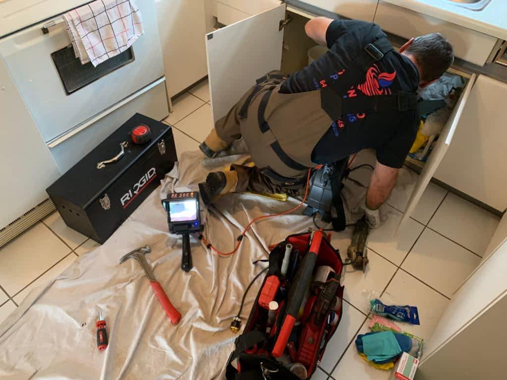 cleaning drains Tornado Plumbing